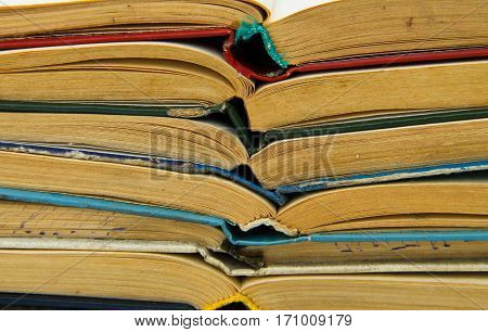 Stack of the old open books. Books background