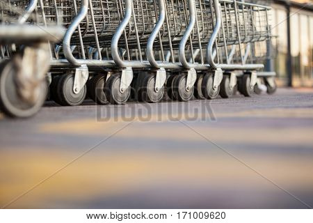 Shopping carts arranged in a row in supermarket