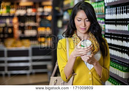Woman shopping for groceries in supermarket
