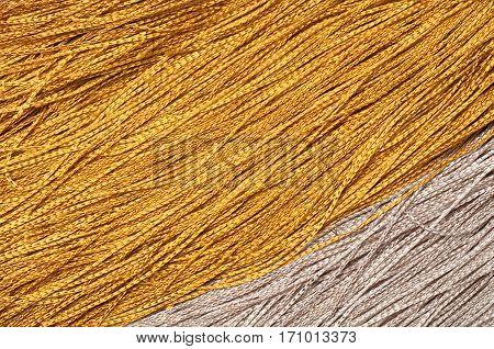 Golden thread filament texture macro close up