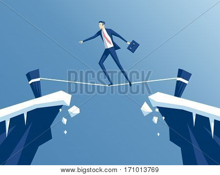 businessman is walking a tightrope across the gap between the rocks. employee of the tightrope walker goes from one mountain to another business concept risk and danger