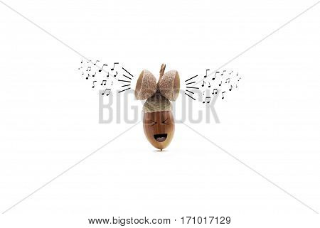 funny oak acorn singing listening to and enjoying its own music isolated on white background