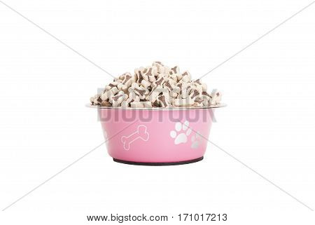 pink dog food bowl filled with kibbles isolated on white background