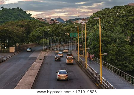 GUAYAQUIL, ECUADOR, FEBRUARY - 2016 - High angle urban view at highway at sunset time in Guayaqui city Ecuador