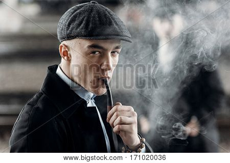 Stylish Man In Retro Outfit, Smoking Wooden Pipe. Sherlock Holmes Look Cosplay.  England In 1920S Th
