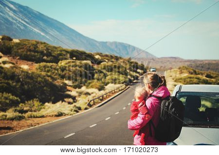 family travel by car-mother with little baby on road in mountains
