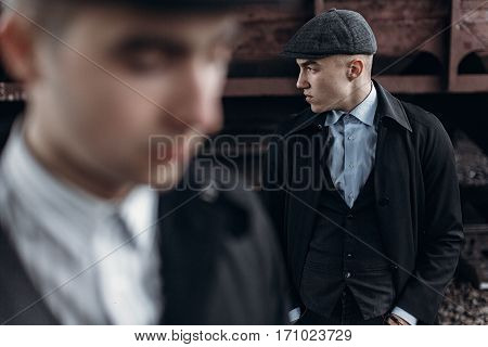 Brutal Gangsters Posing On Background Of Railway Carriage. England In 1920S Theme. Fashionable Confi