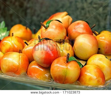 colorful dish with fresh marzipan apricots closeup