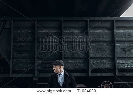 Brutal Gangster Posing On Background Of Railway Carriage. England In 1920S Theme. Fashionable Confid