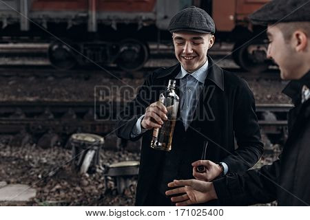 Brutal Gangsters Drinking  On Background Of Railway Carriage. England In 1920S Theme. Fashionable Co