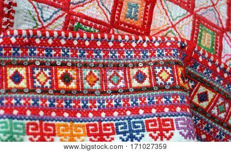 Slavic multicolor hand embroidery pattern macro image