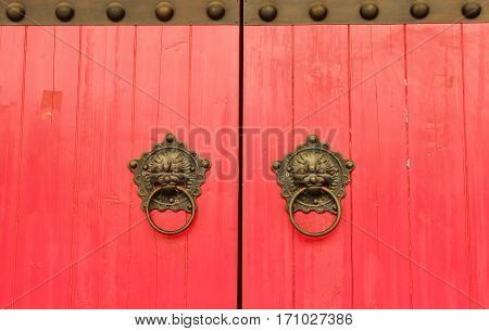 Traditional chinese red wooden gate background closeup