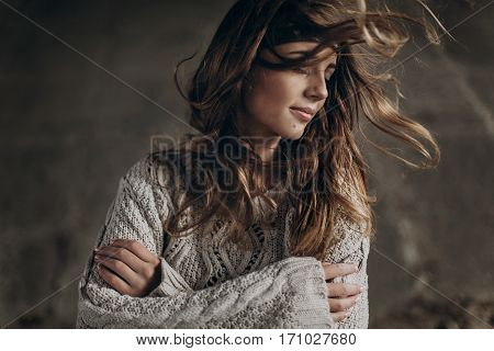 Stylish Hipster Gypsy Woman Posing In Knitted Sweater. Atmospheric Windy Sensual Moment. Boho Countr