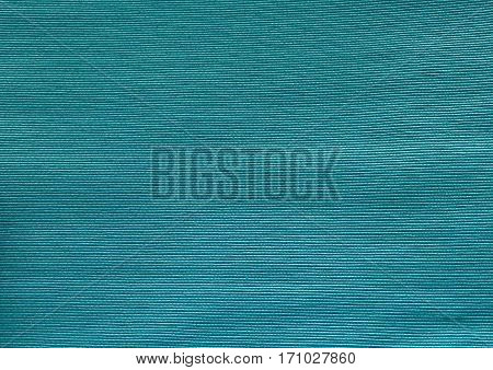 Fabric Texture Close Up of Teal Cotton Pattern Background with Copy Space for Text Decoration.