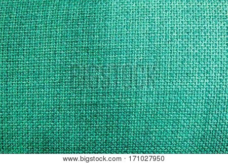 Fabric Texture Close Up of Green Sack or Burlap Fabric Texture Pattern Background in Pastel Colors Tone.