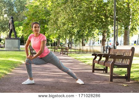 a fitness girl stretching in the park