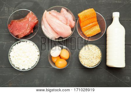 Proteins fish cheese eggs meat and chicken on a black background