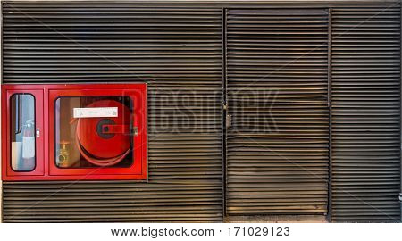 Fire Extinguisher Cabinet in the grunge metal lath wall with copy space