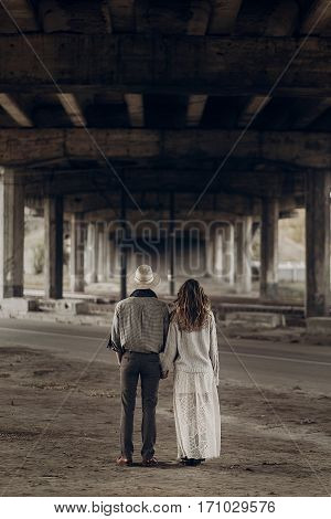 Handsome Texas Cowboy Man In White Hat Holding Hands With Beautiful Gypsy Woman In White Dress, Coup