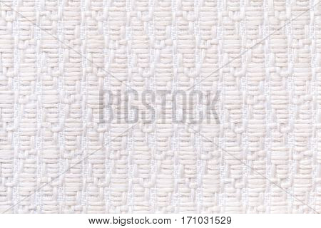 White knitted woolen background with a pattern of soft fleecy cloth. Texture of textile closeup.
