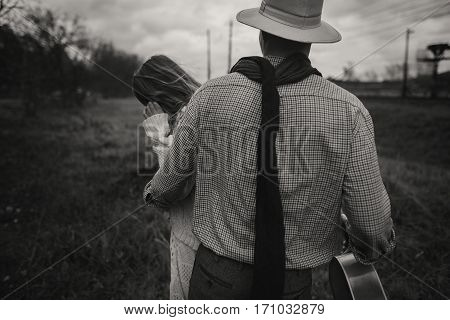 Boho Gypsy Woman And Man In Hat Embracing In Windy Field.stylish Hipster Couple Dancing. Atmospheric