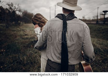 Stylish Hipster Man In Cowboy Shirt And Hat Holding Emotional Beautiful Brunette Woman, Texas Outdoo