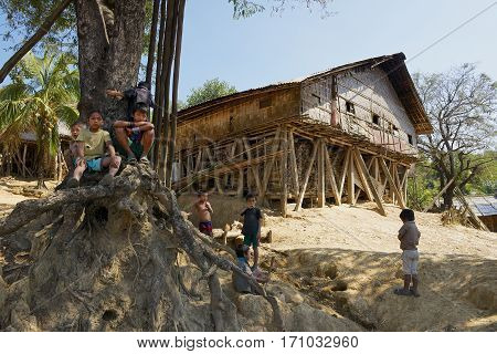 BANDARBAN, BANGLADESH - FEBRUARY 20, 2014: Unidentified children play at the street of the Marma hill tribe village in Bandarban, Bangladesh.
