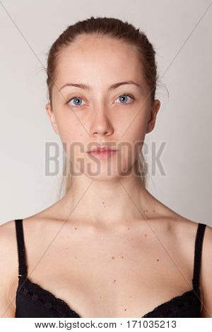 Close-up face portrait of young woman without make-up. Natural image without retouching . Shallow depth of field.