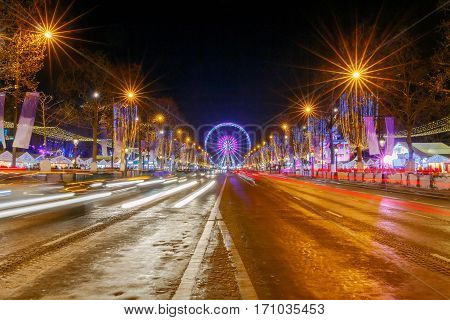 Champs Elysees at night festive lighting for Christmas. Paris. France.