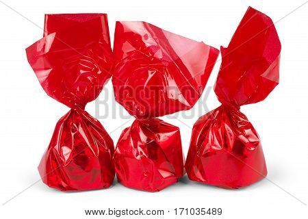 A Piece of Candy or a Cough Drop Wrapped in Bright Red Cellophane Wrapper on a White Background