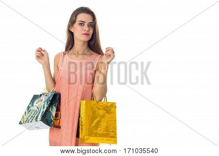 girl with shopping in the hands looks toward isolated on white background