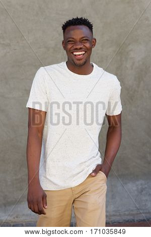 Smiling Young African American Guy Walking Outside