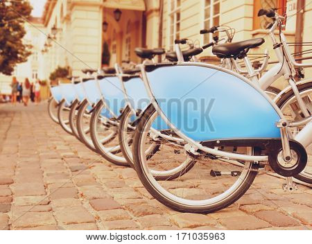 Travel and vacation concept. Parking place with bicycles for rent