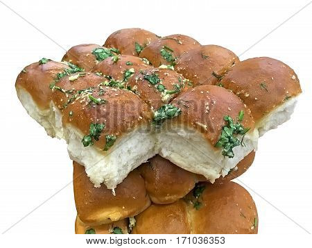 Delicious rolls with garlic and herbs closeup isolated over white