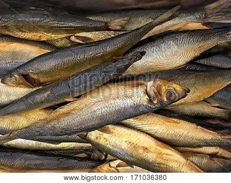 Food background - Mouth-watering smoked fish (mackerel) close-up