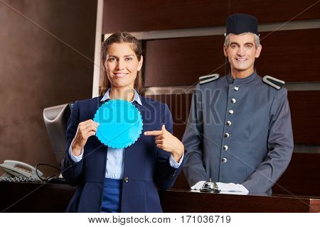 Receptionist and hotel conciergie with a blue blank badge