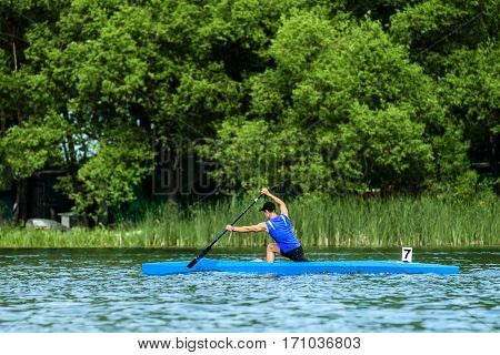 male athlete rowers canoeists paddling on lake rowing competitions