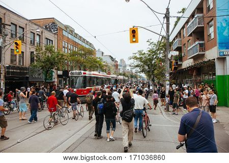TORONTO, CANDA - JUNE 27, 2010: Protestors march along Queen St. in opposition to the G20