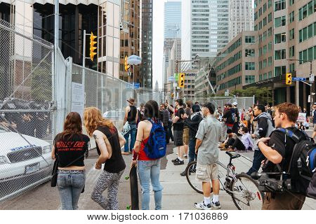 TORONTO, CANDA - JUNE 26, 2010: Protestors approach the fenced permiter of the G20 summit guarded by police officers