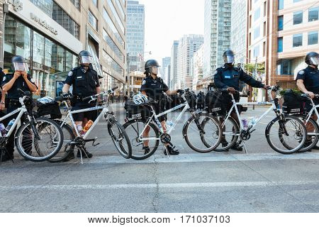 TORONTO, CANDA - JUNE 25, 2010: Police offers form a barricade to block protestors during the G20 summit