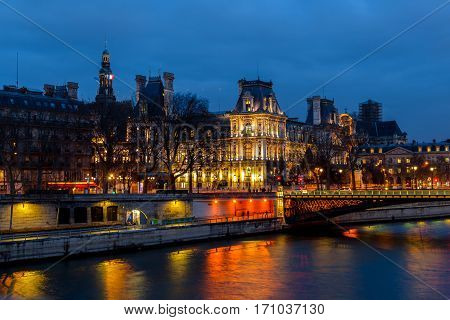 Night view of Hotel de Ville City Hall in Paris , France.