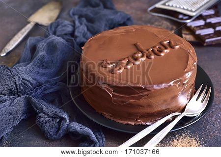 Chocolate Sacher Torte On A Black Plate On A Slate,stone Or Metal Background.