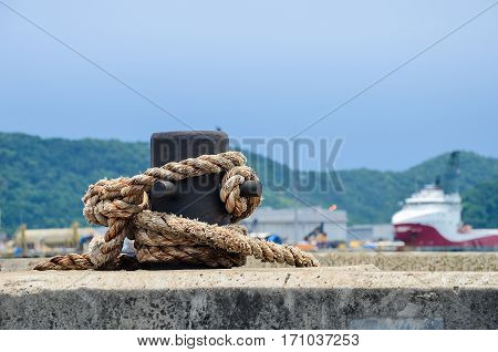 Maritime Rope Wrapped In Iron Support On A Harbor