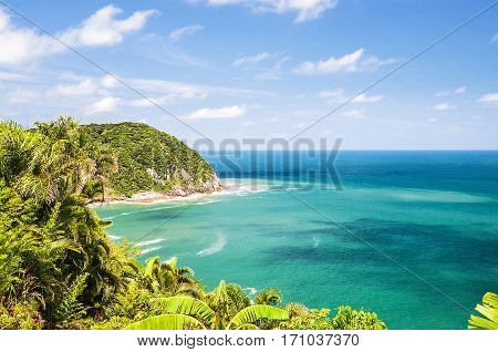 Blue Sea Background With A Mountain Next And Green Vegetation