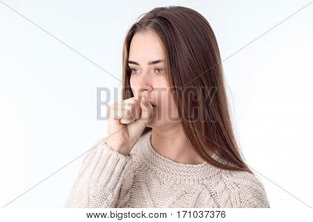 beautiful young woman fell ill and coughing isolated on white background