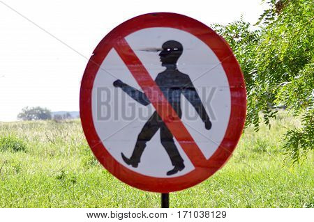 Prohibition sign to walk in the savanna of West Tsavo Park in Kenya