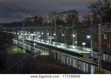 The train station, the train station at night illuminated by streetlights