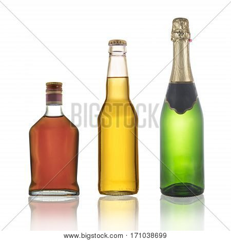 Bottles of cognac champagne and beer with reflections isolated on a white background.