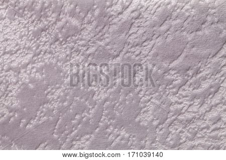Light gray background from a soft upholstery textile material closeup. Fabric with natural texture. Cloth backdrop.