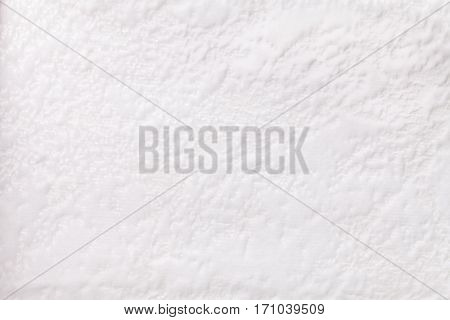 White background from a soft upholstery textile material closeup. Fabric with natural texture. Cloth backdrop.
